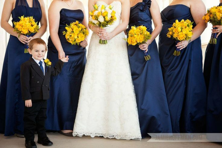 White and yellow bridal bouquet with monochromatic yellow bridesmaid bouquets including roses, tulips, spray roses, alstroemeria and solidago. Wedding flowers by Rosie's Floral Boutique. Photo by Jamie Huffman Photography. #yellowwedding #springwedding #february #bouquets #weddingflowers #bride #navy #yellowandnavy #bridalparty #navybridesmaids #yellowflowers #bridesmaids