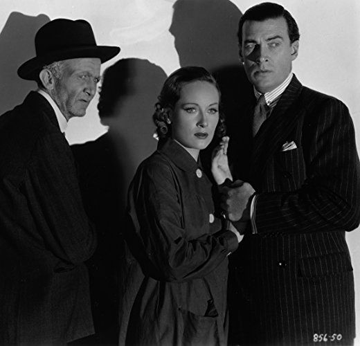 Walter Brennan, Tala Birell, and Walter Pidgeon in She's Dangerous (1937)
