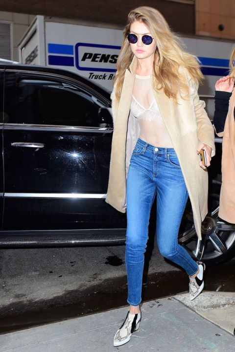Leaving her NYC hotel with boyfriend Zayn Malik in a nude bodysuit worn over a lacy bra with skinny jeans, a camel coat and Rodarte booties.