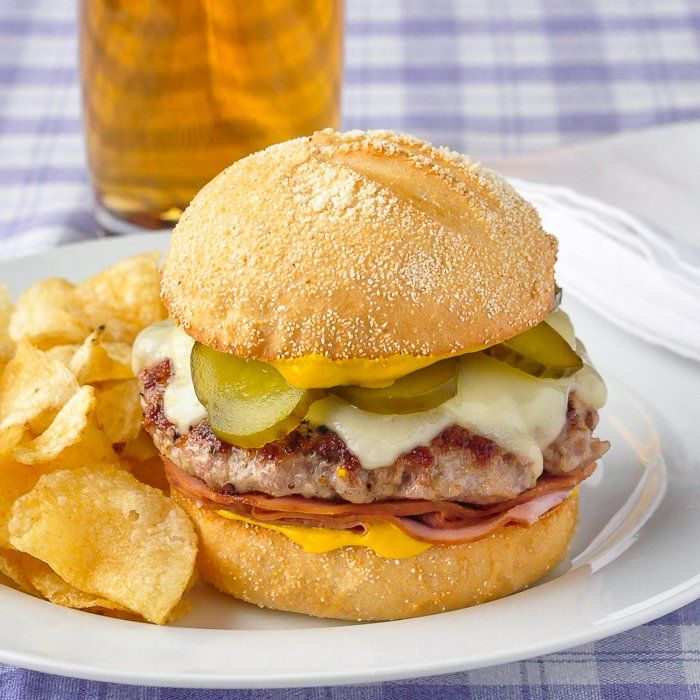 Cuban Sandwich Burger - a simple ground pork patty with deli ham, swiss cheese & mustard on a crusty bun. The flavour of a Cuban Sandwich in much less time!