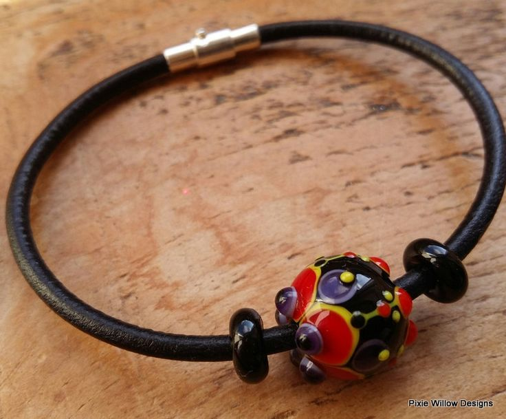 Lipstick jungle Lampwork and leather bangle by Pixie Willow Designs. by pixiewillow on Etsy