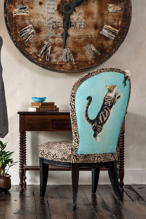 "The Kitsy Kat Side Chair would go PURRRfect in your home! Reprinted artist canvas of ""Kitsy"" reaching for her toy mouse. The black and cream tiger patterned fabric mimics Kitsy's fur color. The seat is eight way hand tied, giving the chair a nice weighted seat."