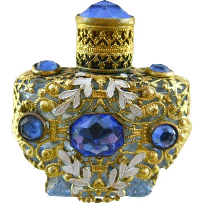 Vintage Czech blue glass jeweled gold filigree perfume bottle                                                                                                                                                     More