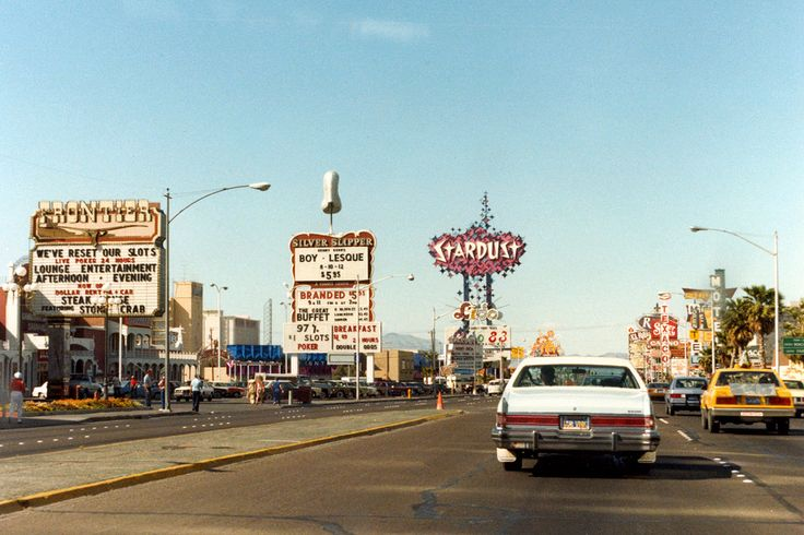 Las Vegas Strip, 1983. Photo by Henk Binnendijk of Frontier, Silver Slipper, and Stardust. The Frontier sign, shown here in front of their race & sports book, is now in the collection at the Neon...
