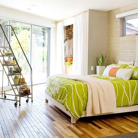A reclaimed ladder stores books and other collectables while acting as decoration. More bedroom storage solutions: http://www.bhg.com/decorating/storage/projects/bedroom-storage-solutions/?socsrc=bhgpin080113ladder=20