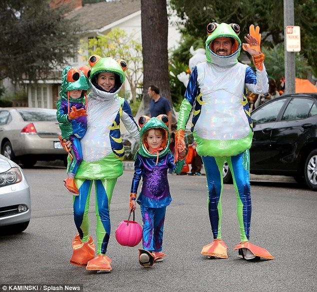 Four frogs: Alyson Hannigan, Alexis Denisof and their daughters Satyana and Keeva trick-or-treated in Los Angeles on Friday