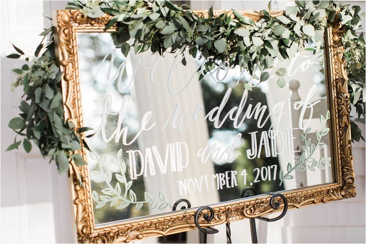 Gold Antique Mirror Wedding Sign with Calligraphy and Greenery Floral Garland at this Fall Southern Plantation Wedding