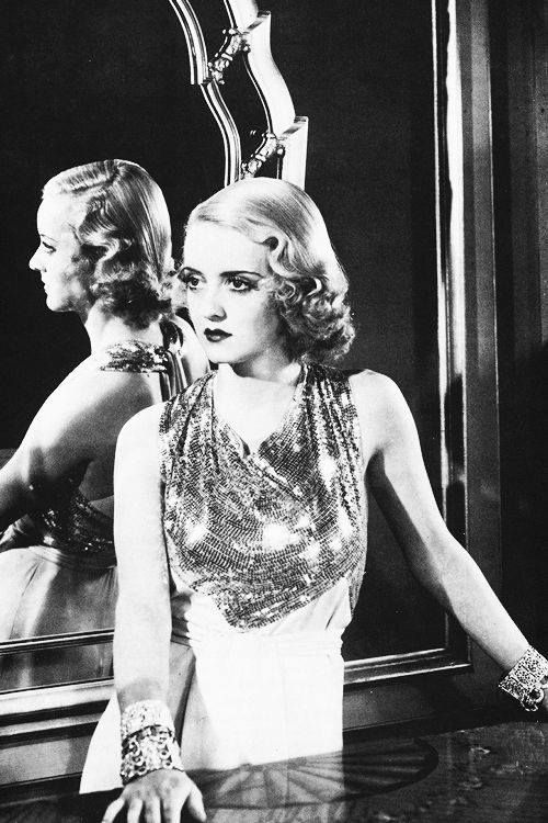 "Bette Davis in a gown by Orry Kelly for ""The rich are always with us"" (1932). Jewelry by Joseff of Hollywood"