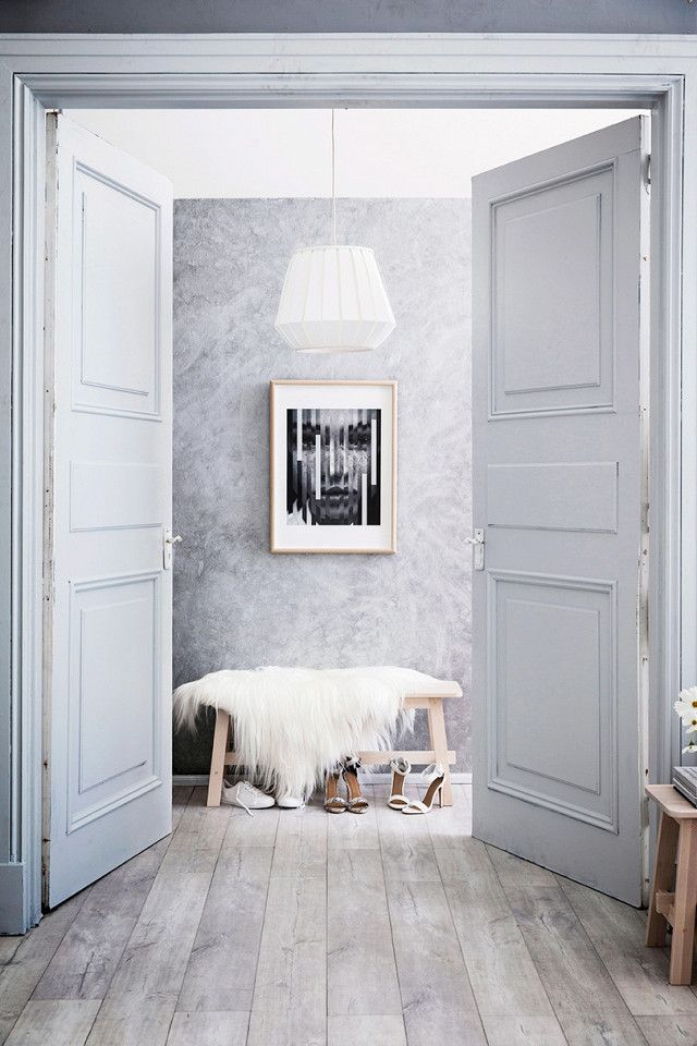 Swedish entryway with gray walls, and gray floors, a white pendant light, black and white photography, and a wooden bench