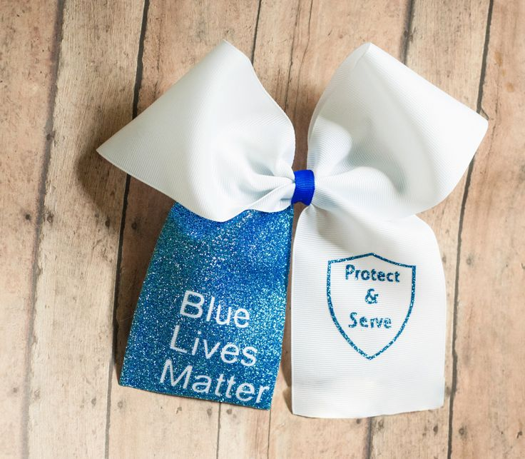 Blue lives matter cheer bow - Cheer bow - blue cheer bow - White Cheer Bow - Glitter Cheer Bow - Sparkly Cheer Bow - Police bow - Big Bow by Meadowsbowboutique on Etsy https://www.etsy.com/listing/292721351/blue-lives-matter-cheer-bow-cheer-bow