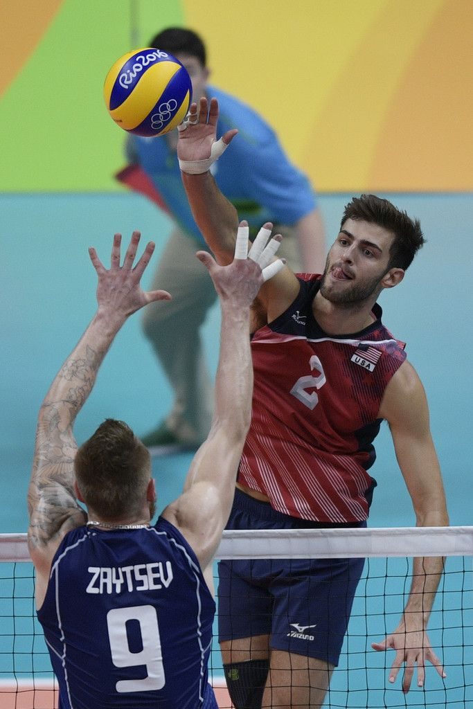 USA's Aaron Russell spikes the ball during the men's semi-final volleyball match between Italy and USA at Maracanazinho Stadium in Rio de Janeiro on August 19, 2016, at the Rio 2016 Olympic Games. / AFP / Juan Mabromata