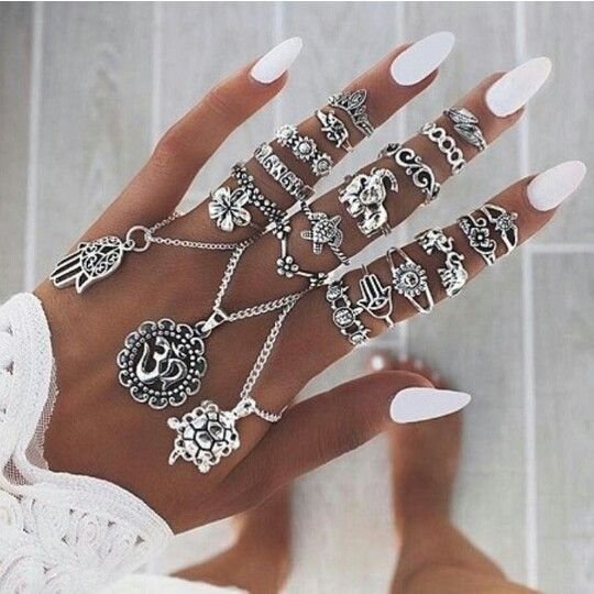 Rings on rings on rings - white almond shaped nails