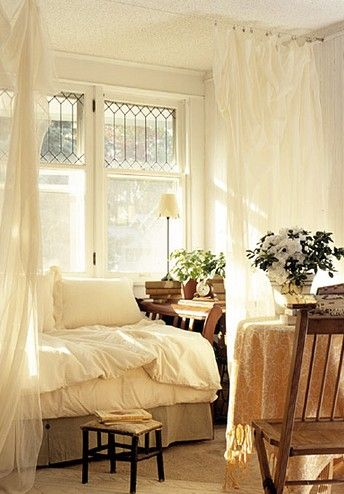 Cozy white bedroom with leaded glass windows