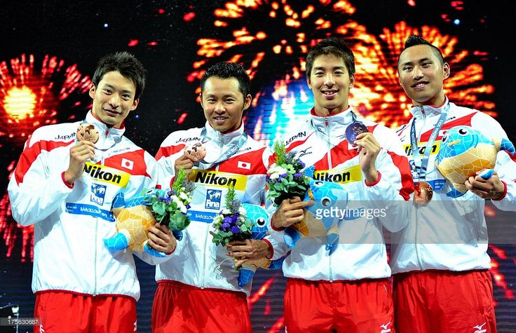 Bronze medal winners Ryosuke Irie, Kosuke Kitajima, Takuro Fujii and Shinri Shioura of Japan celebrate on the podium after the Swimming Men's Medley 4x100m Relay Final on day sixteen of the 15th FINA World Championships at Palau Sant Jordi on August 4, 2013 in Barcelona, Spain.