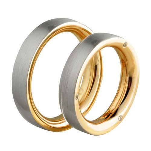 0brączki ślubne z białego i różowego złota z brylantami o łączznej masie 0,03 ct. Próba 0,585