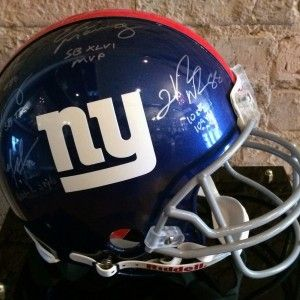 Eli Manning,Victor Cruz,Hakeem Nicks,and Mario Manningham autographed New York Giants Superbowl stats helmet. Certified by Steiner Sports.