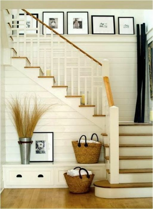 love the stairwell shelf and storage for an otherwise unused space