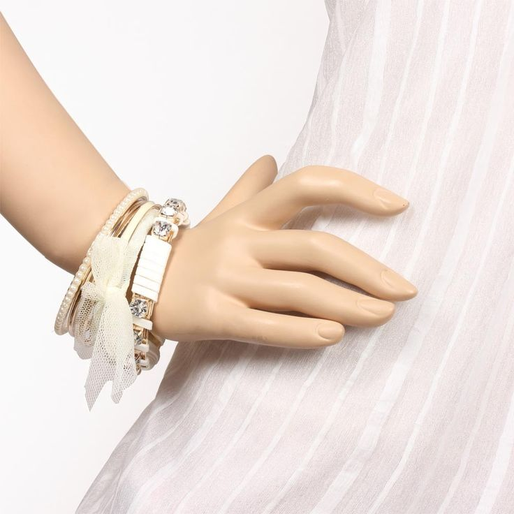 Want to look like a celeb???? Yes, then you need Classy White Colored Bangle Set, which is creatively designed and studded with white stones.  Visit for buy:- http://khoobsurati.com/khoobsurati/classy-white-colored-bangle-set