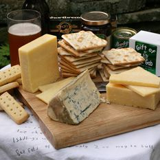 Gourmet Assortments: From Ireland, Kerrygold Dubliner, Wexford Mature Cheddar, Cashel Blue, Follain Irish Jam, Gift of Gab Tea, Jacob's Cream Crackers, Bewley's Irish Creme Coffee, Shortbread Petticoat Tails.