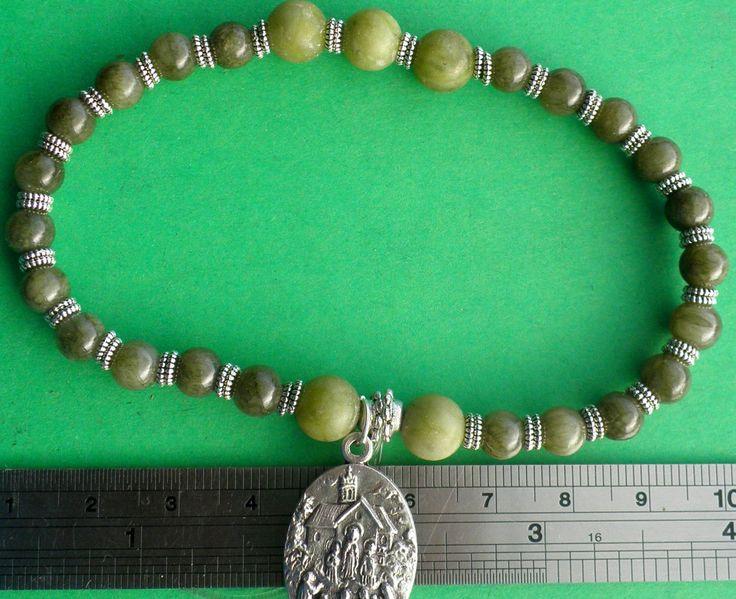 Irish Catholic Stretch Bracelet, Connemara Marble Beads, Lady of Knock Medal with Holy Water capsule, by VintageIrishDresser on Etsy