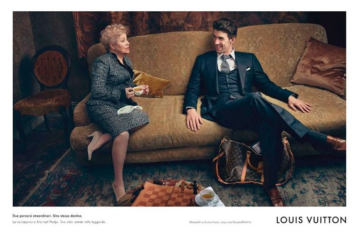 Michael Phelps for Louis Vuitton Core Values. He stars alongside former Soviet gymnast Larisa Latynina, who won 18 Olympic medals in the 1950s and '60s. She held the world record for the Olympic athlete with the most medals until Phelps beat her last month. Photographed by Annie Leibovi