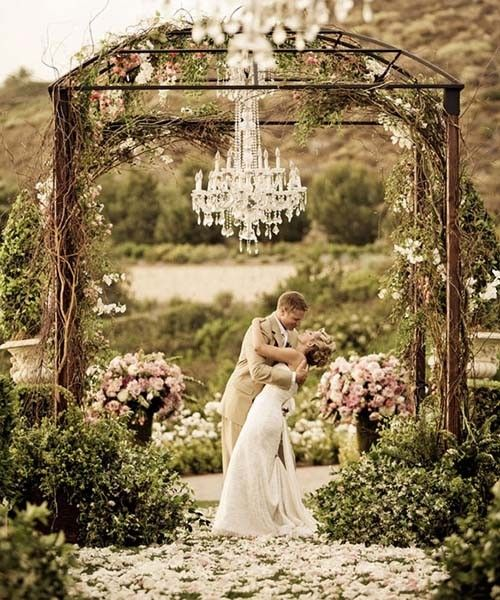 stunning garden for your ceremony, crystal chandelier idea for spring weddings, green spring weddings