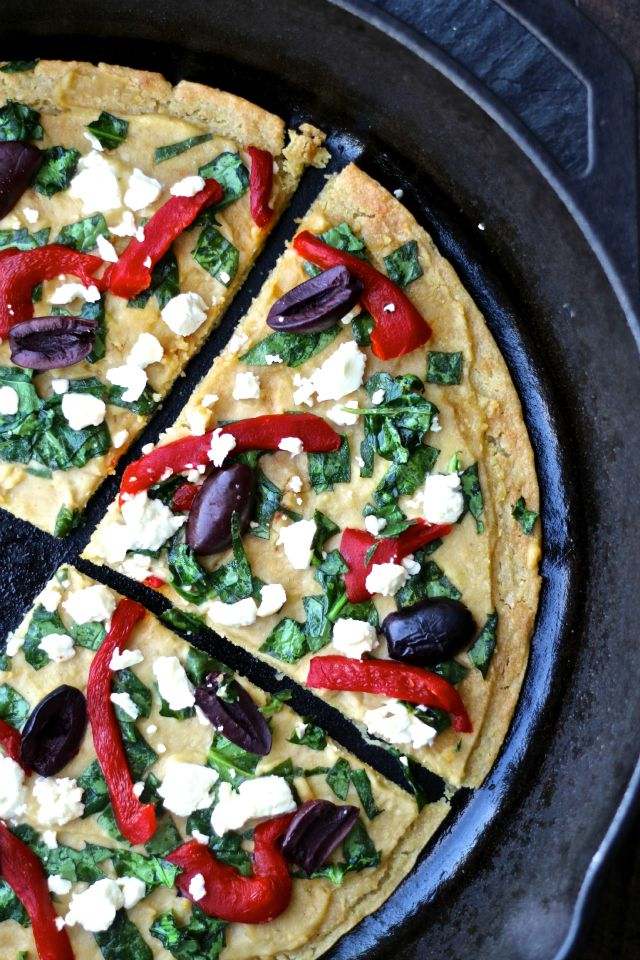 Turn up the flavor with this Mediterranean-inspired pizza dish made with Sabra Hummus and a delicious chickpea crust. #vegetarian #pizza