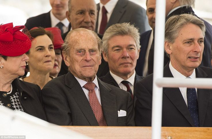 Having fun: The Duke of Edinburgh was pictured grinning as he sat on the boat alongside Fo...
