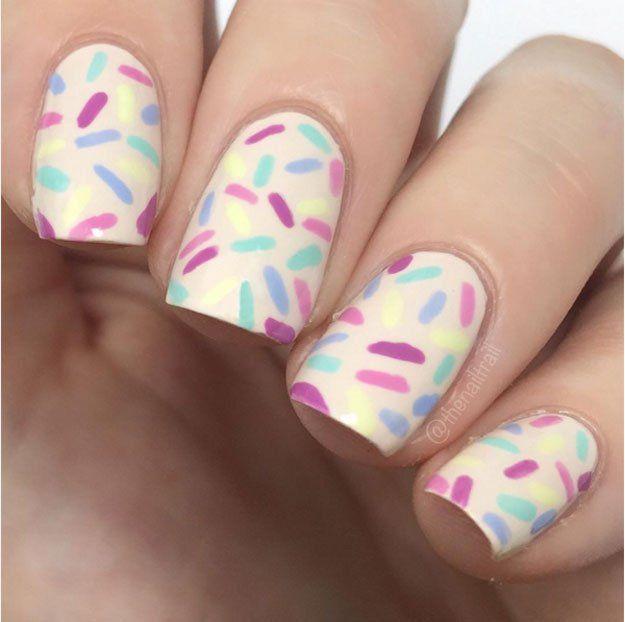 Funfetti Nail Art | 23 Spring Nail Art Designs, check it out at http://makeuptutorials.com/nail-designs-spring-nail-art/