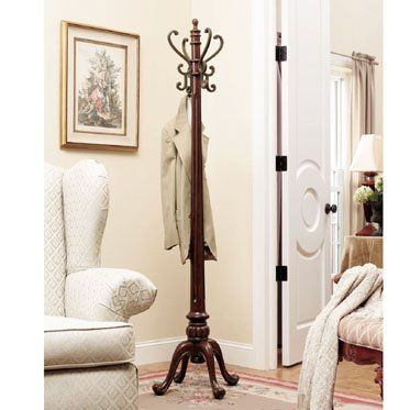 """Barrier Reef """"Warm Nut Brown"""" Coat Rack by FurnitureMaxx.com. $169.99. Product Dimension :19""""L X 19""""W X 72.125""""H. Some Assembly Required. Features antique brass textured hooks to hang your coats and hats.. Queen Anne styled legs feature detailed carvings.. """"Warm Nut Brown"""" Finish. Provides style and function to any room.. Thick 4:1/2"""" diameter fluted posts taper to four hand forged antique brass textured hooks. There are four elegantly curved Queen Anne legs with det..."""