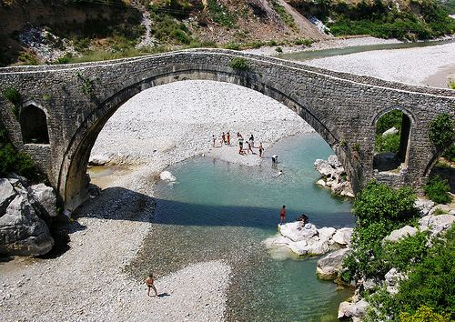 Swimming under Mesi Bridge, Kiri River, near Shkodra, Albania by David, via Flickr.  Just look at that bridge!