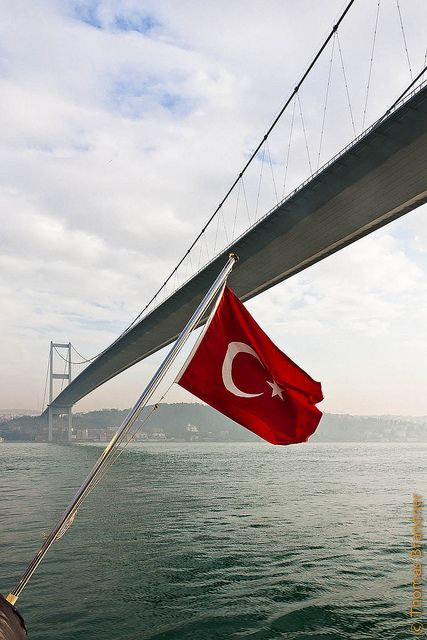 Turkish flag and Bosphorus Bridge in Istanbul..