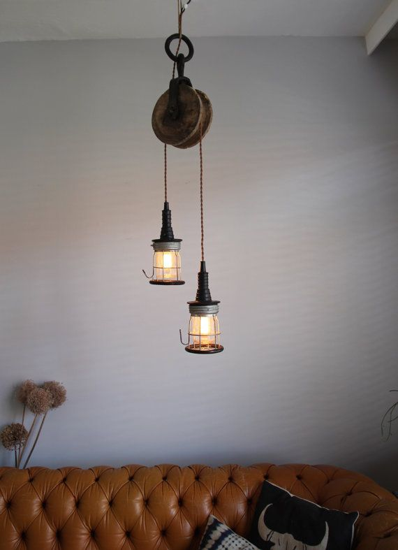 Industrial lighting. Hanging lamp made from a vintage pulley and cage lights. Loft light, ceiling lighting, chandelier, pendant lights, barn