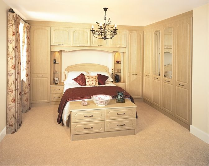 The Ashford Maple bedroom has a traditional over-the-bed design and features Alcove units above the bedside drawer units. With neutral tones and illuminated Alcoves, this design is the ideal look for a traditional bedroom.