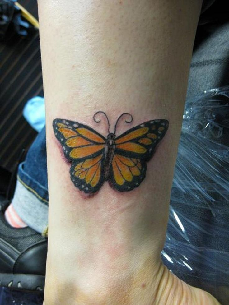 Yellow butterfly tattoo