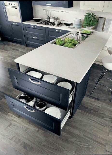 Like floor and counter tops with black cabinets