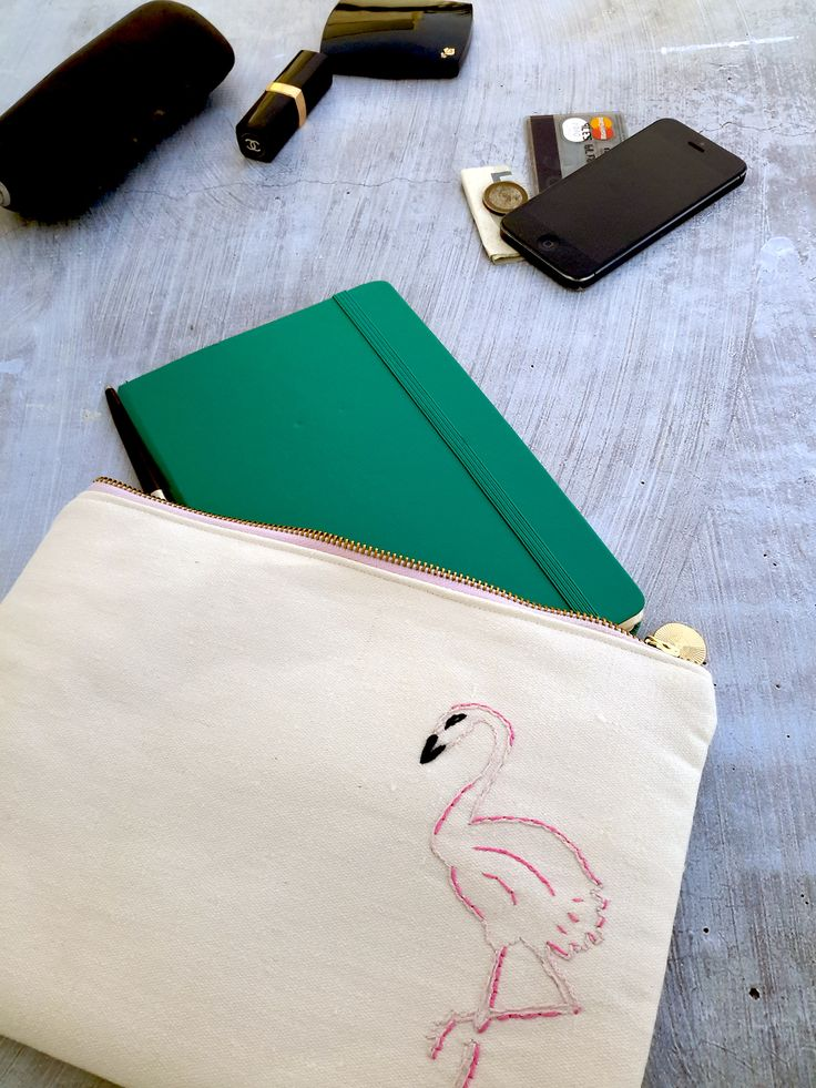 Into flamingos? How about this oversized pink flamingo pouch?