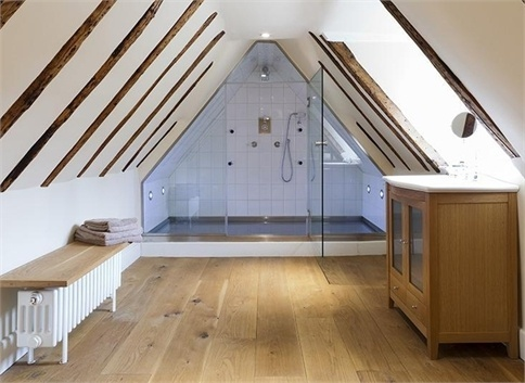 Attic bathroom with wood beams and big shower