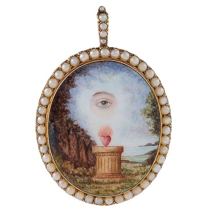 An 1800's English Georgian 18K gold and porcelain enamel memorial pendant with half pearls. This unique pendant is composed of symbolic elements of memorial jewelry. In this piece, the pearl frame signifies tears, the flaming heart and the lover's eye denote a passionate love that had ended.