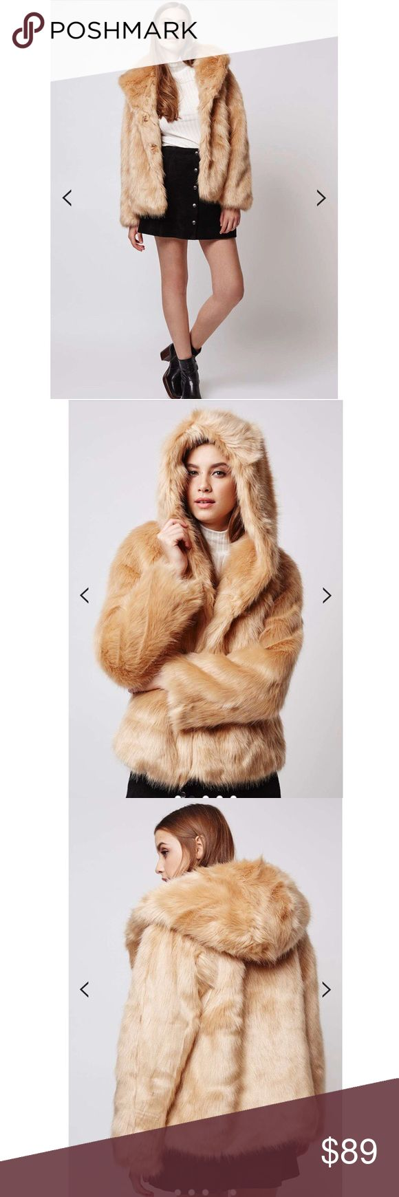 """Topshop Faux Fur Hooded Coat NWOT Retails for $170- Sold Out Camel Color Luxe faux fur comes reinvented for now in smooth caramel tones - perfect for the season ahead. This boxy fit coat is easy to shrug on, detailed with an oversized hood for added cosiness and comes with side pockets and a front popper fastening. Coat is fully lined for added warmth. 53% Modacrylic, 47% Acrylic. Dry clean only.  Model's height is 5' 9.5"""" Armpit down is about 13 inches Armpit to armpit is about 22 inches…"""