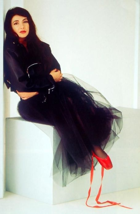 Kate Bush with black tulle skirt and red ballet slippers