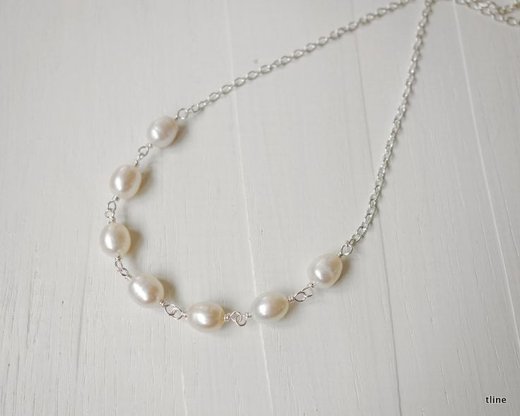 Chain necklace white freshwater pearls. Classic but modern style necklace with a chain and white freshwater pearls. Minimalist necklace for any woman.