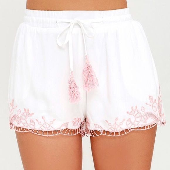 SUNDAY SALE White Embroided Shorts Lounge around with this White Embroidered Shorts featuring a lightweight woven fabric that starts at a smocked waistband with a tassel drawstring and a pink embroided hem below. Fully lined. 100% Viscose. Made in USA. Tea n Cup Shorts