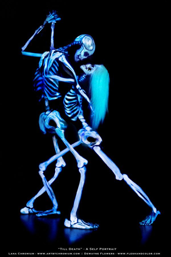 """Body paint artist Dewayne Flowers was inspired by body paint artist Lana Chromium, to have his own body painted after twenty years of painting other people. They painted each other for this lovely blacklight picture. They carefully planned the finished image, and filled in the necessary extra """"cross bones"""" where their arms and legs would cross. The name of the resulting art is """"Till Death"""" - A Self Portrait. Flowers explained a little more about the picture:This was a spontaneous..."""