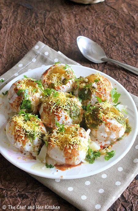 DAHI PURI | CHAAT RECIPES       Ingredients: 14 small puffed puris(Homemade/Readymade) 1/3 cup Moong sprouts,steamed 2 Potatoes,boiled,peeled and chopped 1 Onion,finely chopped 1/4 cup chopped fresh Coriander 1/3 cup fine Sev 1 1/2 cups fresh thick Curd 2-3 tbsp Sugar 1/4 cup Kharjur-Imli chutney 1/4 cup Green chutney 1 tbsp roasted Cumin powder 1 tsp Red chili powder 1 tsp Chaat masala Salt to taste