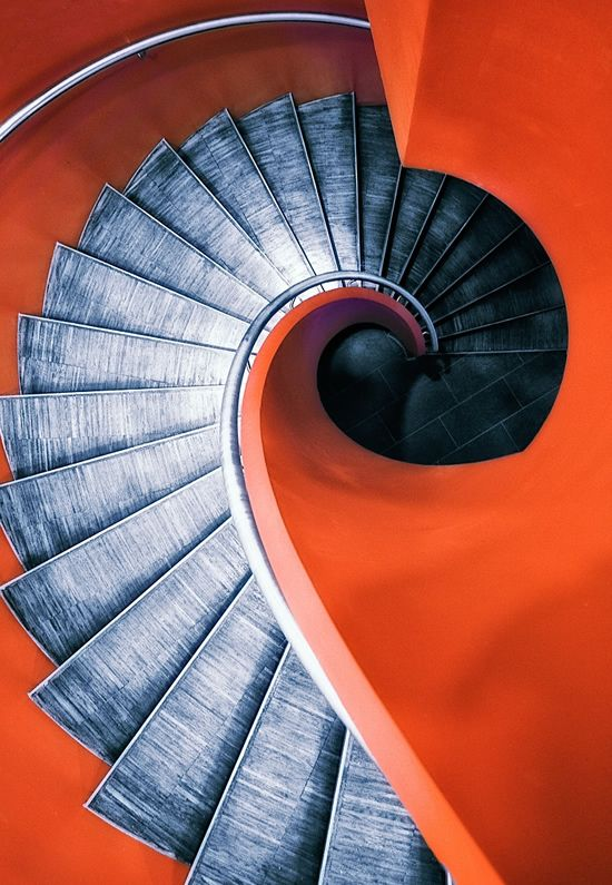 Awesome spiral staircase. Love the combination of orange and black.