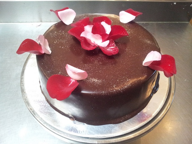 Wicked Chocolate cake decorated with rose petals by Charly's Bakery, via Flickr