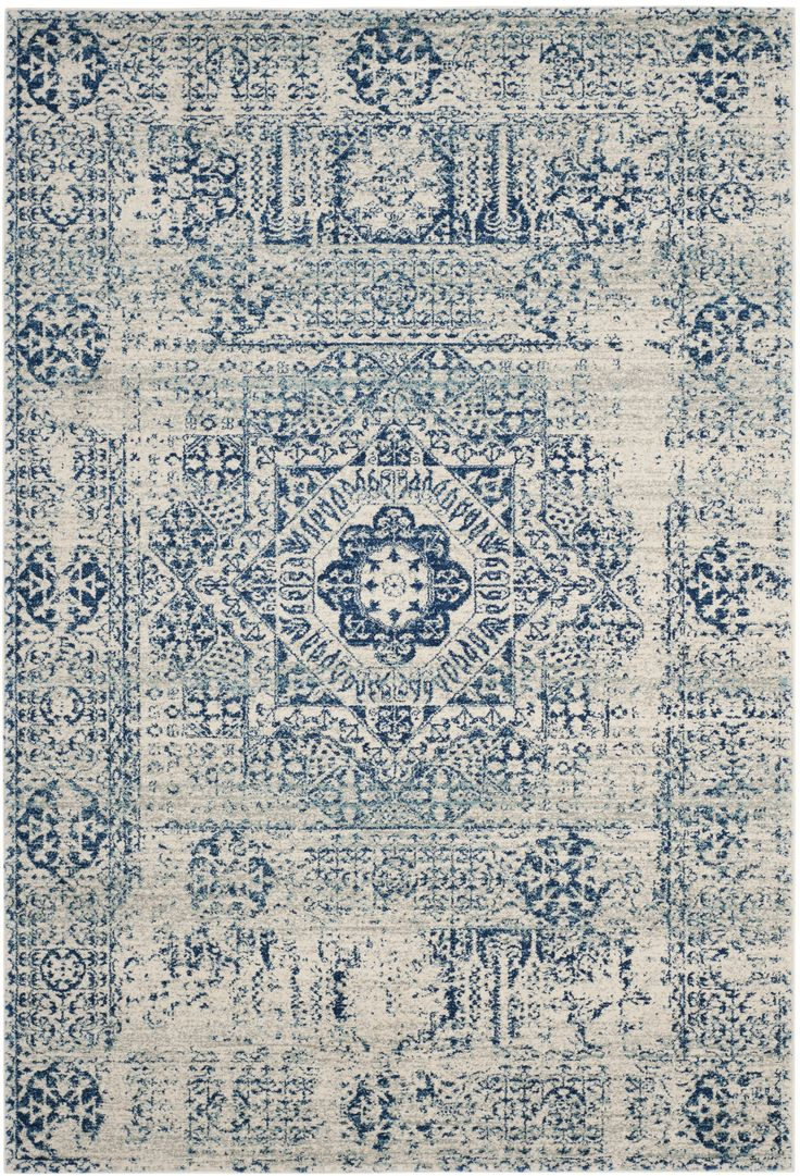 Features:  -Power loomed.  -Bohemian style.  Technique: -Machine woven.  Primary Color: -Blue/Ivory.  Material: -Synthetic.  Rug Shape: -Rectangle.  Product Type: -Area Rug.  Material Details: -100% P