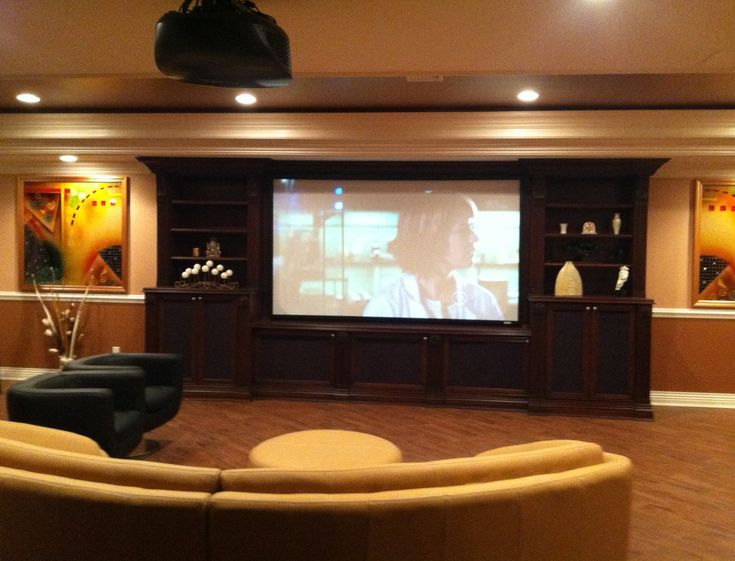Decoration Remarkable Home Movie Theater Rooms Ideas By Large Screen On The Black Wooden Frame With Shelves Combined Yellow Sofa Laminated