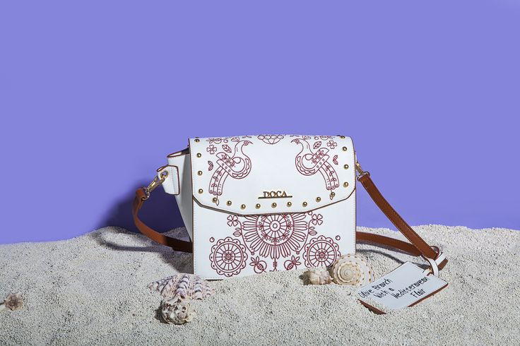 "GREEK SPIRIT Inspired by the sea`s deep blue and Greek island`s white, our new 'Greek Spirit' collection will virtually tour you to the Aegean and Ionian islands. The slogan of the line is ""My Greek Island Home"" and ""Olive Branch with a Mediterranean Flair"". Stunning handmade engraved details and prints on bags and wallets embellish our new collection.  www.doca.gr #greekspirit #greek #island #blue #fashion #patterns"